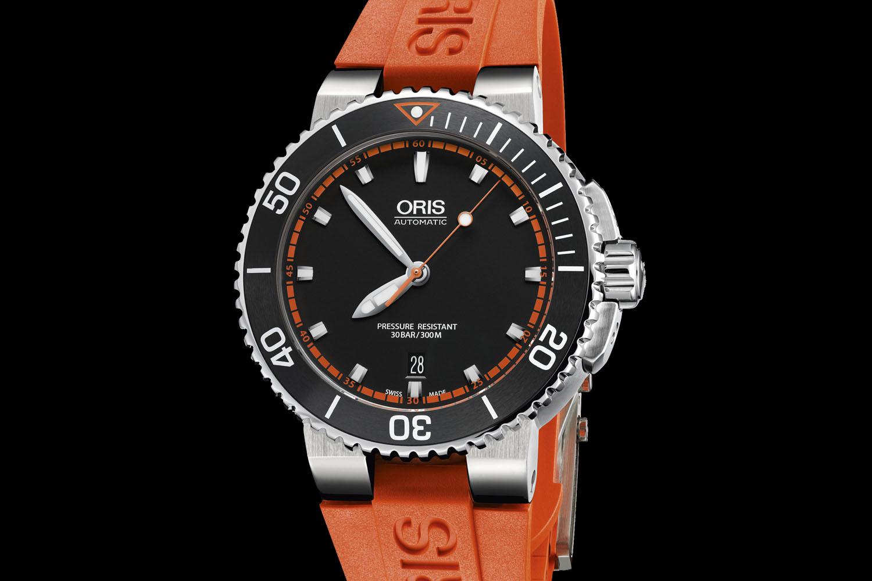 Oris Aquis Date orange strap watch