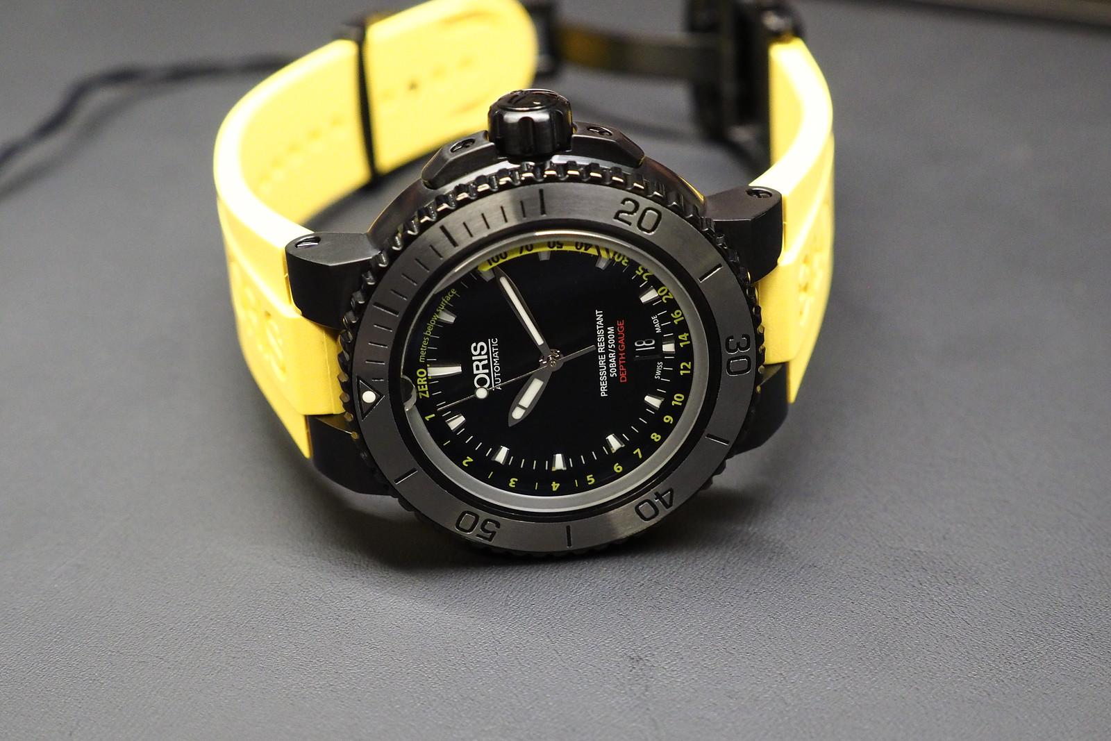 Side of Oris Aquis Date yellow strap watch
