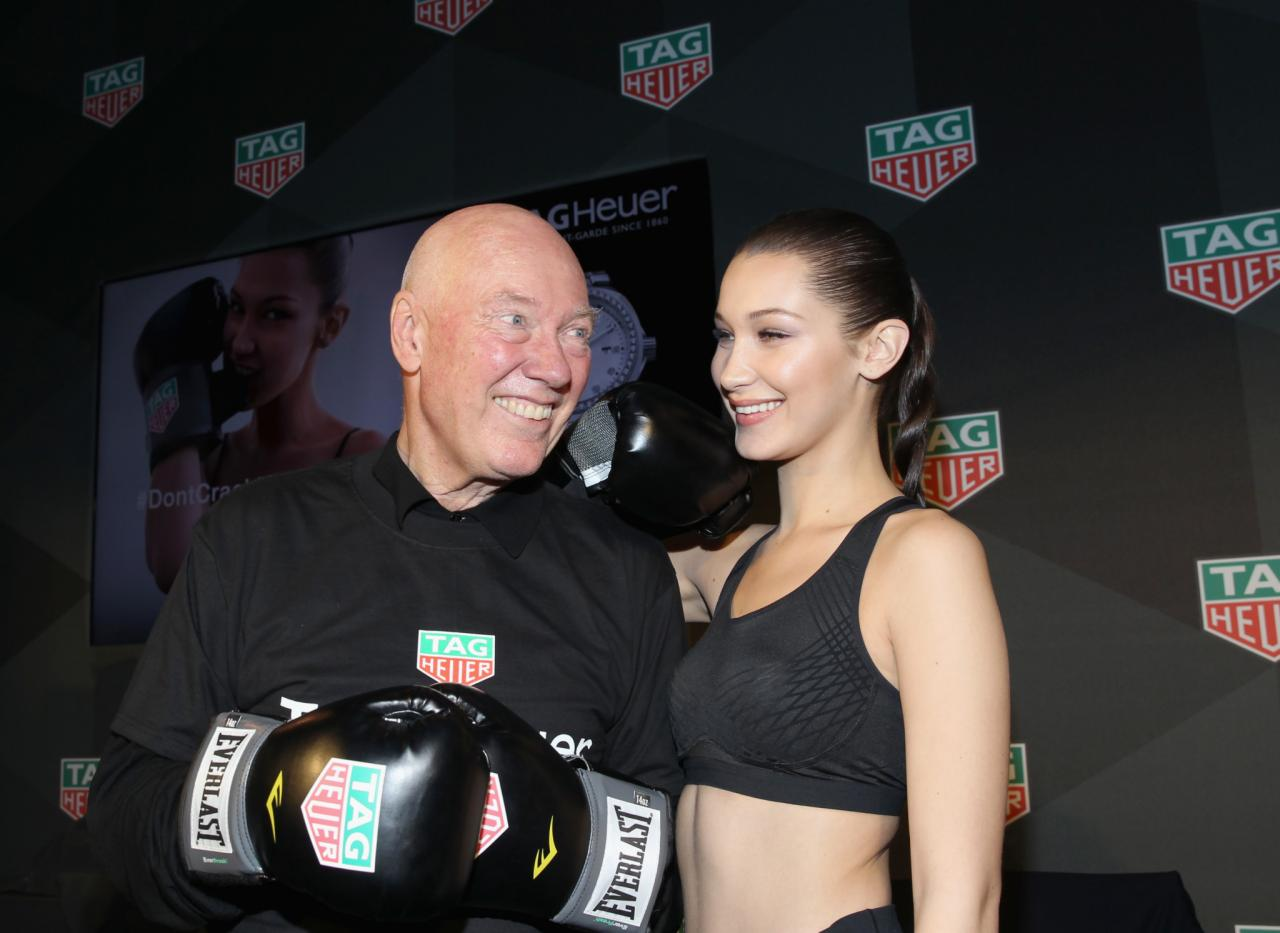 CEO of TAG Heuer Jean-Claude Biver (L) and Bella Hadid pose during A Fresh New Face For TAG Heuer. These collaborations are broadening the customer base for the brand. (Photo by Bennett Raglin/Getty Images for TAG Heuer)