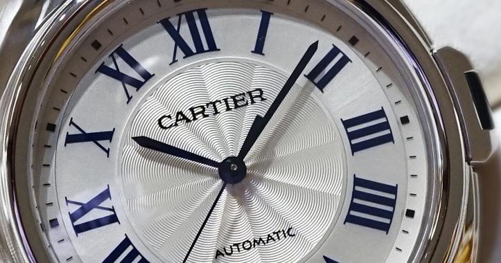 Clé De Cartier stainless steel watch dial